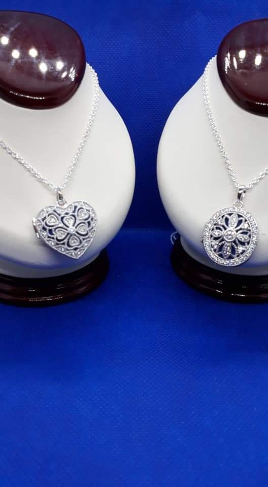 New silver items lockets and crosses